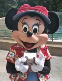 Minnie Mouse holding the CD AVALON